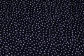 Polyester mousselin in black with white dot