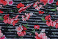 Black and grey across-striped cotton-jersey with coral flowers.