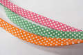 Piping with dots - pink, orange or green.