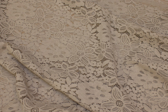 Sand-colored lace-fabric