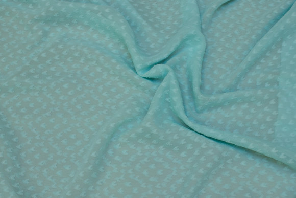 Transparent, mint-colored chiffon with small flock-motif