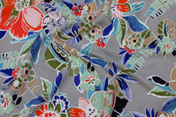 Sand-colored viscose-mousselin with flowers in blue and red