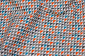 White cotton with small triangle-pattern in grey and orange and turqoise