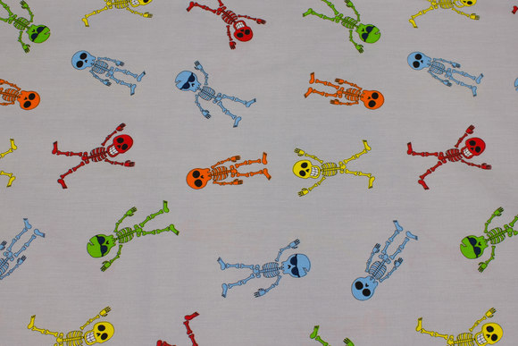Light grey, woven cotton with fun colorful skeletons