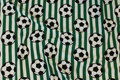 Green and white across-striped cotton-jersey with soccer balls.