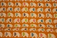 Organic orange cotton with elephants on a row