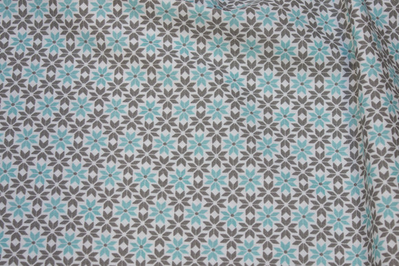White cotton with small flowers in grey and mint