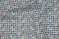 White cotton with small triangle-pattern in grey and mint.