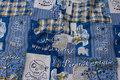 Blue patchwork-cotton with pirate-motifs.