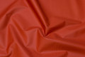 Windproof windbreaker fabric in rust color.