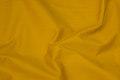 Windproof windbreaker fabric in brass yellow.