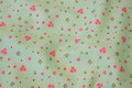 Light apple-green cotton with small pink roses