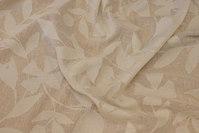 Jacquard-woven, lightweight transparent gardinstof in off-white.