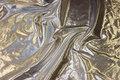 Thin silver decorative fabric.