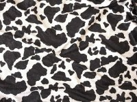 Crushed velvet in shiny quality with cow print.