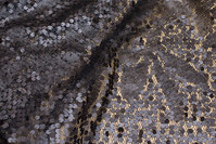 Beautiful net-fabric, in dark brungrå, with sewn-on sequins