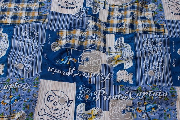 Blue patchwork-cotton with pirate-motifs