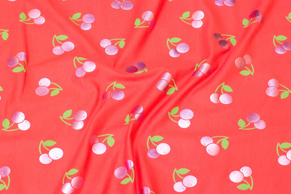 Coral red cotton-jersey with shiny, pink cherries