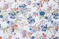 Delicate light blue viscose-jersey with flowers.