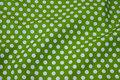 Kiwi-green cotton with 1 cm white dots .