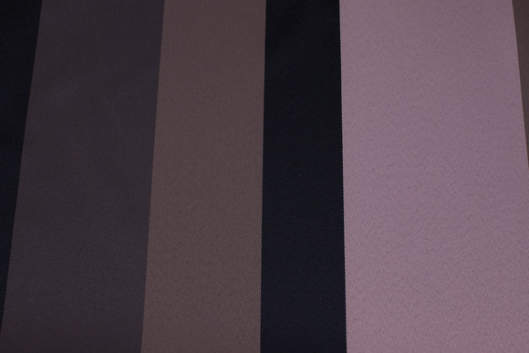 Medium-thickness polyester in old rose, black and jordfv. with wide stripes along fabric