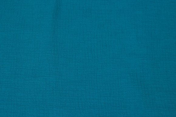 Soft double woven cotton (double-gaze) in petrol-colored