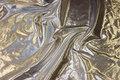 Thin silver decorative fabric.