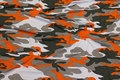 Viscosejersey camouflage with orange.