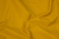 Windproof windbreaker fabric in brass yellow.