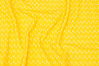 Yellow cotton-jersey with small ca. 1 cm circle-pattern.