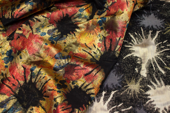Beautiful, shiny brocade in gold, black, silver and red