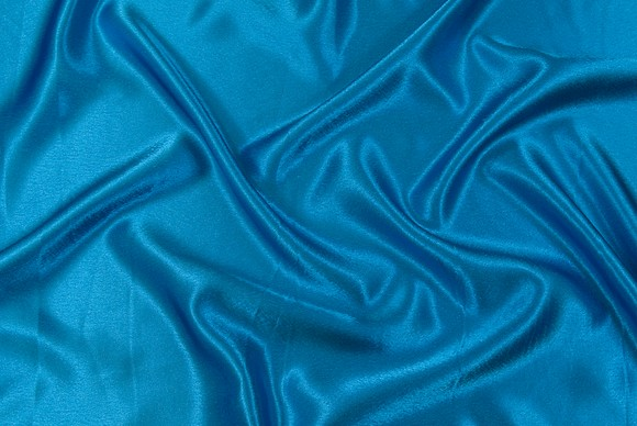 Crepe sateen in blue-turqoise