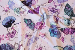 Delicate light-purple cotton-jersey with flowers and butterflies