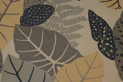 Grey textile-table-cloth with leaves in navy and dirt-colors
