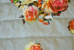 Light grey double-sided quilt with roses