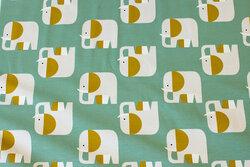 Medium-green, organic cotton-jersey with ca. 5 cm elephants