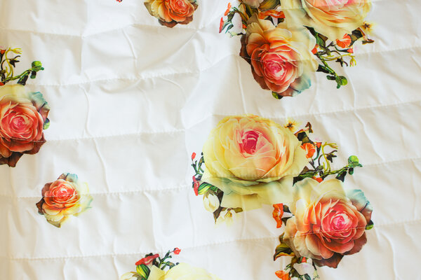 Off white double-sided quilt with roses
