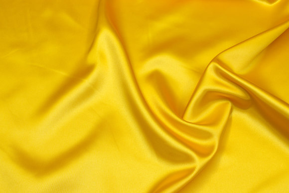 Polyestersatin in sun-yellow