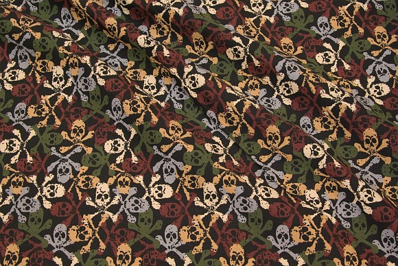 Rugged cotton canvas with skulls in black, brown, green