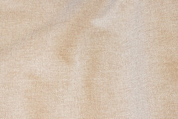 Speckled, light sand-colored opholstry fabric in polyester