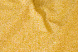 Speckled, straw-yellow opholstry fabric in polyester