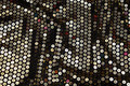 Stretch-sequins-fabric in black with big sewn-on gold sequins