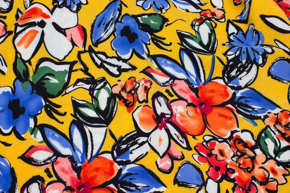 Lightweight, yellow micro-polyester with big flowers in red and blue