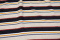 Lightweight viscose mousselin, stripes along fabric, in beige and black and yellow.