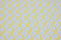 Yellow cotton ned light grey circle-pattern.