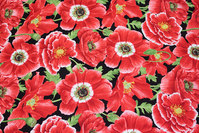Patchwork-cotton with beautiful red flowers.