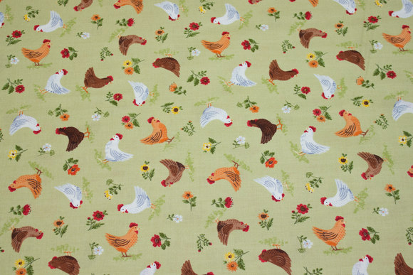Delicate, light green patchwork-cotton with ca. 3 cm big chickens