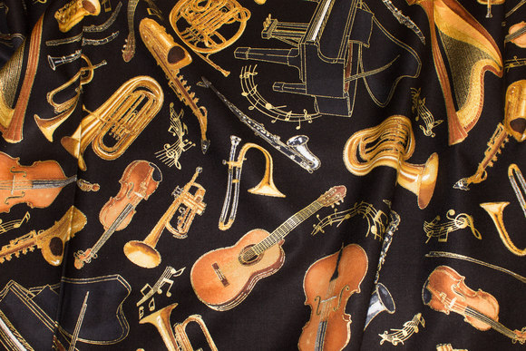 Music instruments on patchwork-cotton