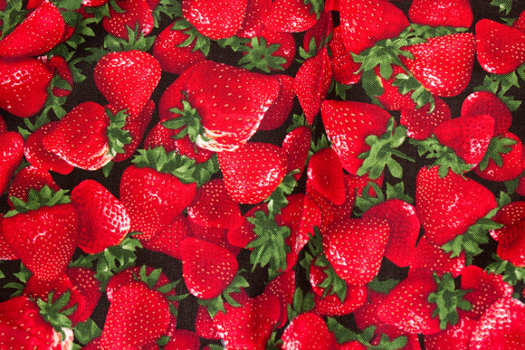 Beautiful strawberries on patchwork-cotton