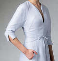 Lined dress has shaped yokes, close-fitting bodice, skirt with one-way front pleat, seam detail, side front pockets, attached belt, two-piece sleeves, shaped bands, slits, and continuous bias to finish hemline and seam allowances. Note: instructions are given for quilting yokes and bands. NOTIONS: 20 inches/22 inches Invisible Zipper, Hook and Eye.